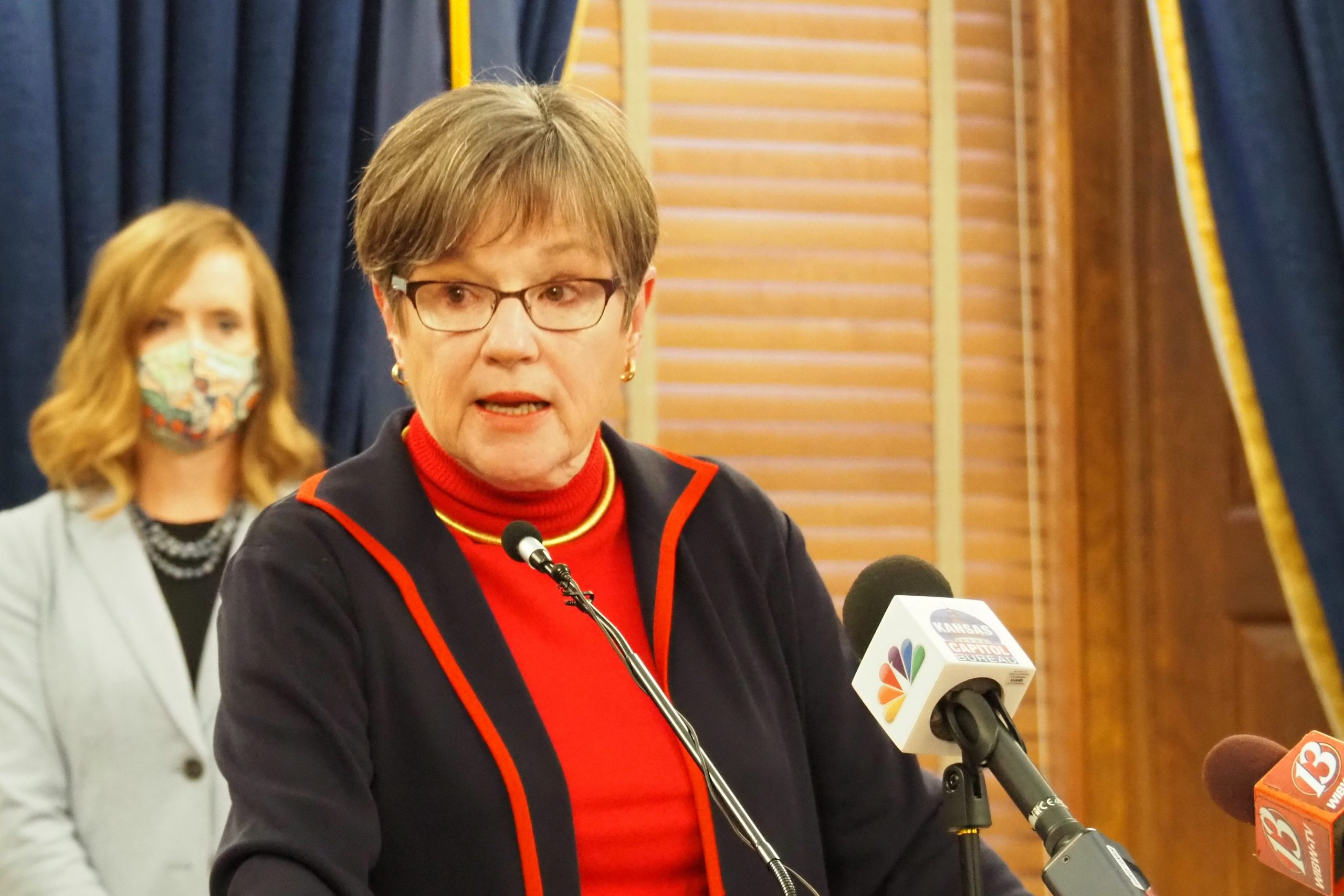 Gov. Laura Kelly joined with House and Senate Democratic leaders to propose Tuesday an increase in the standard deduction on state income taxes. The GOP-led Senate accepted the tax cut, but refused to approve a revenue increase to make it revenue-neutral. (Noah Taborda/Kansas Reflector)