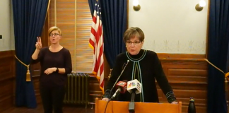 Gov. Laura Kelly and KDHE secretary Lee Norman say resolution of delays in reporting vaccinations will elevate Kansas' standing in national rankings once IT problems are sorted out. (Screenshot/Kansas Reflector)