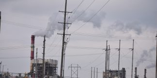 The Kansas Senate is considering a bill endorsed by Evergy, owners of this Lawrence power plant, that would allow refinancing of debt on old coal-burning facilities to be paid through issuance of bonds backed by ratepayers. Questions remain about whether consumers would be guaranteed rate reductions. (Jill Hummels/Kansas Reflector)