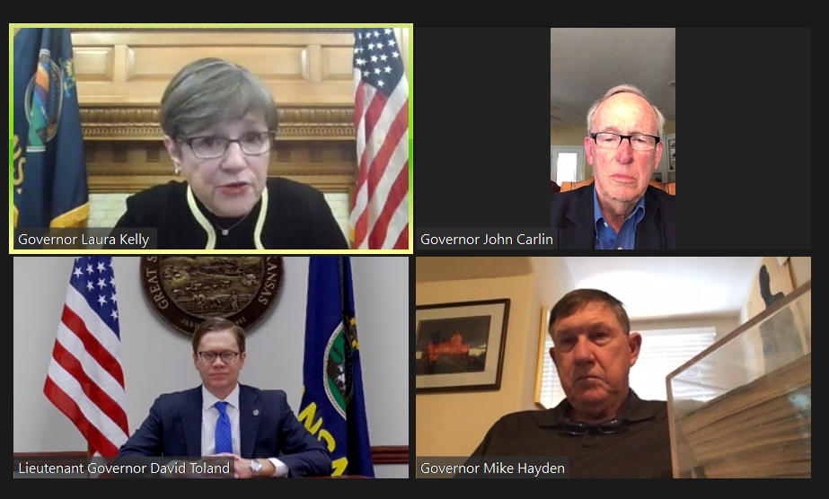 A foursome, moving clockwise, of Gov. Laura Kelly, former Gov. John Carlin, former Gov. Mike Hayden and current Lt. Gov. David Toland shared optimism Thursday for a new statewide economic development blueprint and importance of bipartisan support for job growth. (Screenshot/Kansas Reflector)