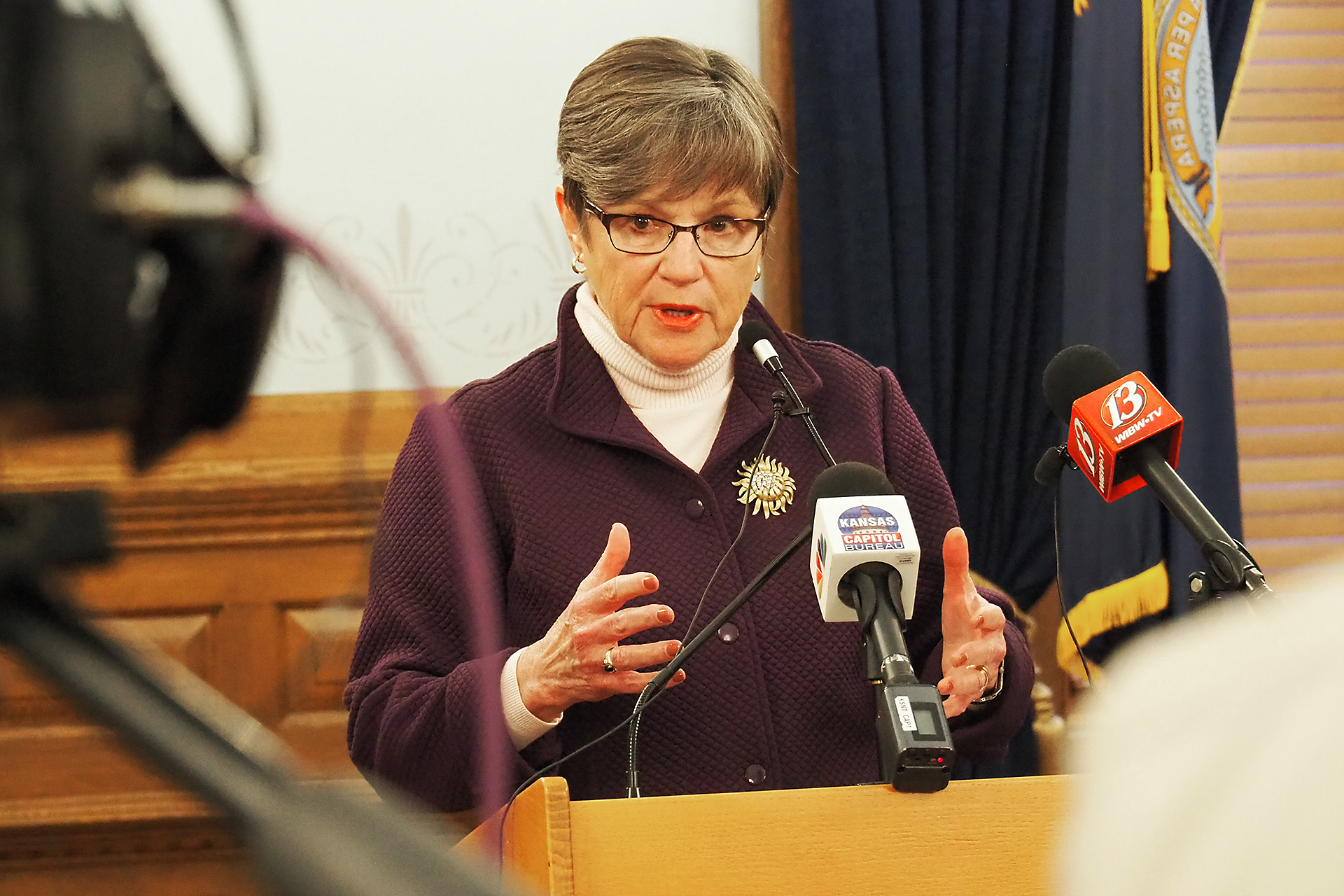 Gov. Laura Kelly signed Senate Bill 40 that broadened the Legislature's oversight powers during the COVID-19 pandemic and indicated she would re-issue a dozen executive orders April 1, including guidance on wearing masks. (Sherman Smith/Kansas Reflector)