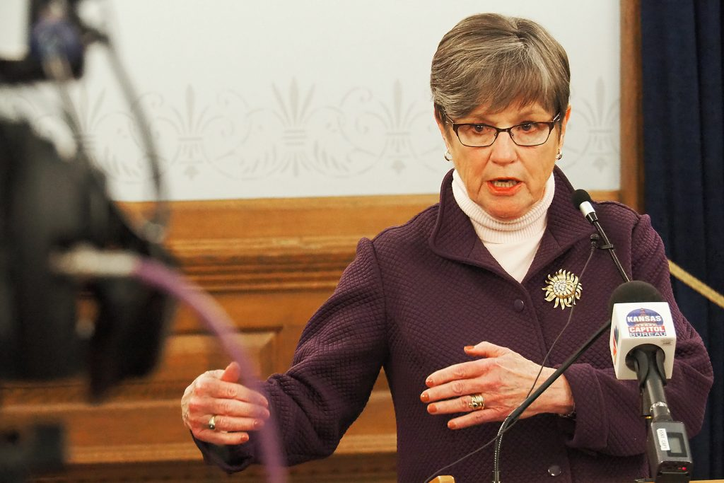 """Gov. Laura Kelly vetoed a bill extending duration of short-term health insurance policies that she labeled """"junk,"""" and called on the Legislature to expand access to Medicaid. (Sherman Smith/Kansas Reflector)"""
