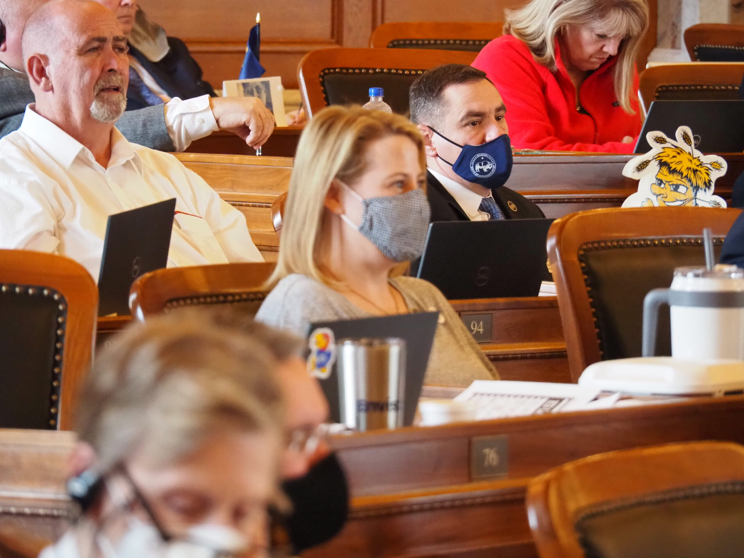 Rep. Pat Proctor, R-Leavenworth, center wearing mask, questioned a new internet sales tax but voted for the House's tax bill because Democratic Gov. Laura Kelly damaged the economy through the pandemic. (Tim Carpenter/Kansas Reflector)