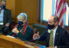 Democratic Rep. Cindy Neighbor, left, and GOP Rep. Steven Johnson embrace bill allowing issuance of $1 billion in bonds to drive investments that help with unfunded liability to state workers and teacher pensions. (Screen capture/Kansas Reflector)
