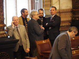 Senate President Ty Masterson, far right in photo, and other members of the Legislative Coordinating Council plan to consider Tuesday a request from Gov. Laura Kelly for a 30-day extension of the state's disaster declaration on COVID-19. (Tim Carpenter/Kansas Reflector)