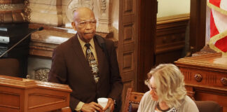 """The Rev. Cecil Washington, who regularly delivers opening prayers in the Kansas Senate, urged senators to consider """"law or policy without love is just empty regulation."""" (Sherman Smith/Kansas Reflector)"""