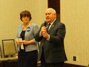 U.S. Rep. Ron Estes, R-Kan., with his wife Susan at a state GOP gathering, said the nation's founders didn't believe any state should host the nation's capitol and opposes making the District of Columbia the 51st state. (Tim Carpenter/Kansas Reflector)