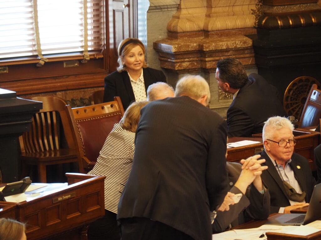 Parker Republican Sen. Caryn Tyson, facing, confers with Senate President Ty Masterson, head turned, on the Senate floor during debate on a package of legislation last week at the Capitol. (Tim Carpenter/Kansas Reflector)