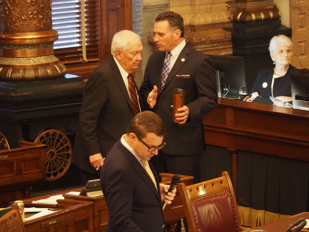 McPherson Republican Sen. Rick Wilborn, standing left with Senate President Ty Masterson, questioned wisdom of holding congressional and legislative redistricting meetings with the public without key Census data expected to arrive in September. (Tim Carpenter/Kansas Reflector)