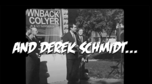 The Democratic Governors Association dipped into the video archive for Republican gubernatorial candidate Derek Schmidt's endorsement of then-Gov. Sam Brownback in an attempt to damage Schmidt's bid for higher office in 2022. (Screen capture/Kansas Reflector)