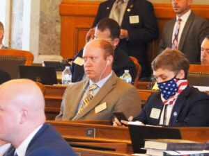 Conservative Republican Rep. Brett Fairchild of St. John, left, and liberal Democratic Rep. Aaron Coleman of Kansas City both supported a bill passed by the House to legalize consumption of marijuana for medical purposes. (Tim Carpenter/Kansas Reflector)