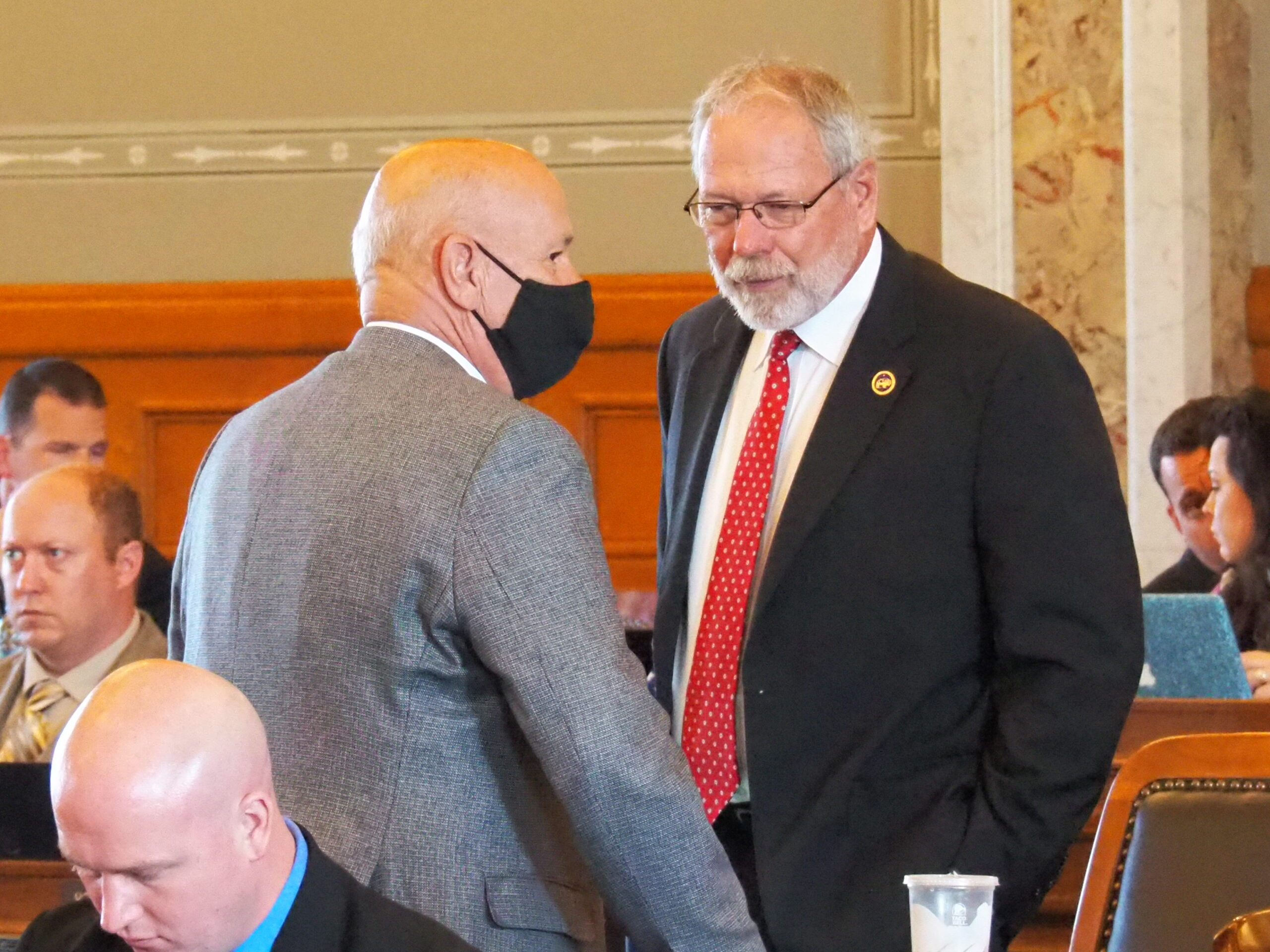 El Dorado Republican Rep. Will Carpenter, facing, led a charge in the House to override Gov. Laura Kelly's veto of $300,000 for an Andover pilot program to help women caught in human trafficking. (Tim Carpenter/Kansas Reflector)