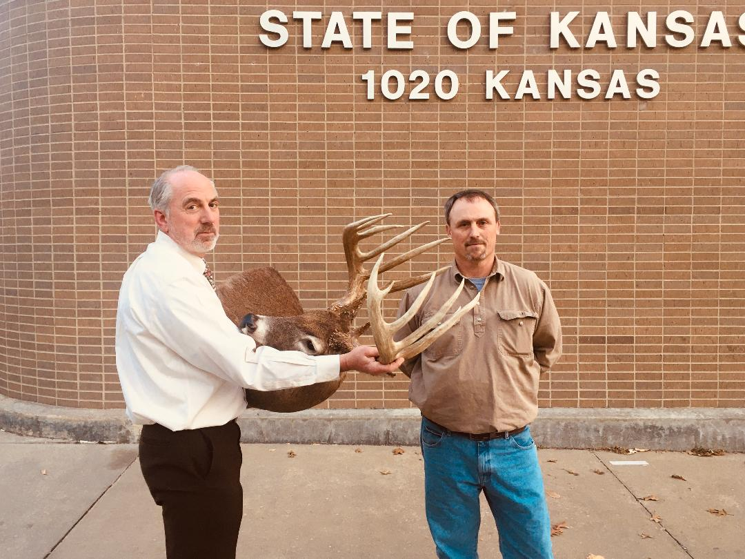Tim Nedeau can exhale after Gov. Laura Kelly signed a bill allocating $16,001 to reimburse him for what he paid the Kansas Department of Wildlife, Parks and Tourism to obtain trophy antlers from a buck illegally hunted on his property in Osage County. (Submitted/Kansas Reflector)