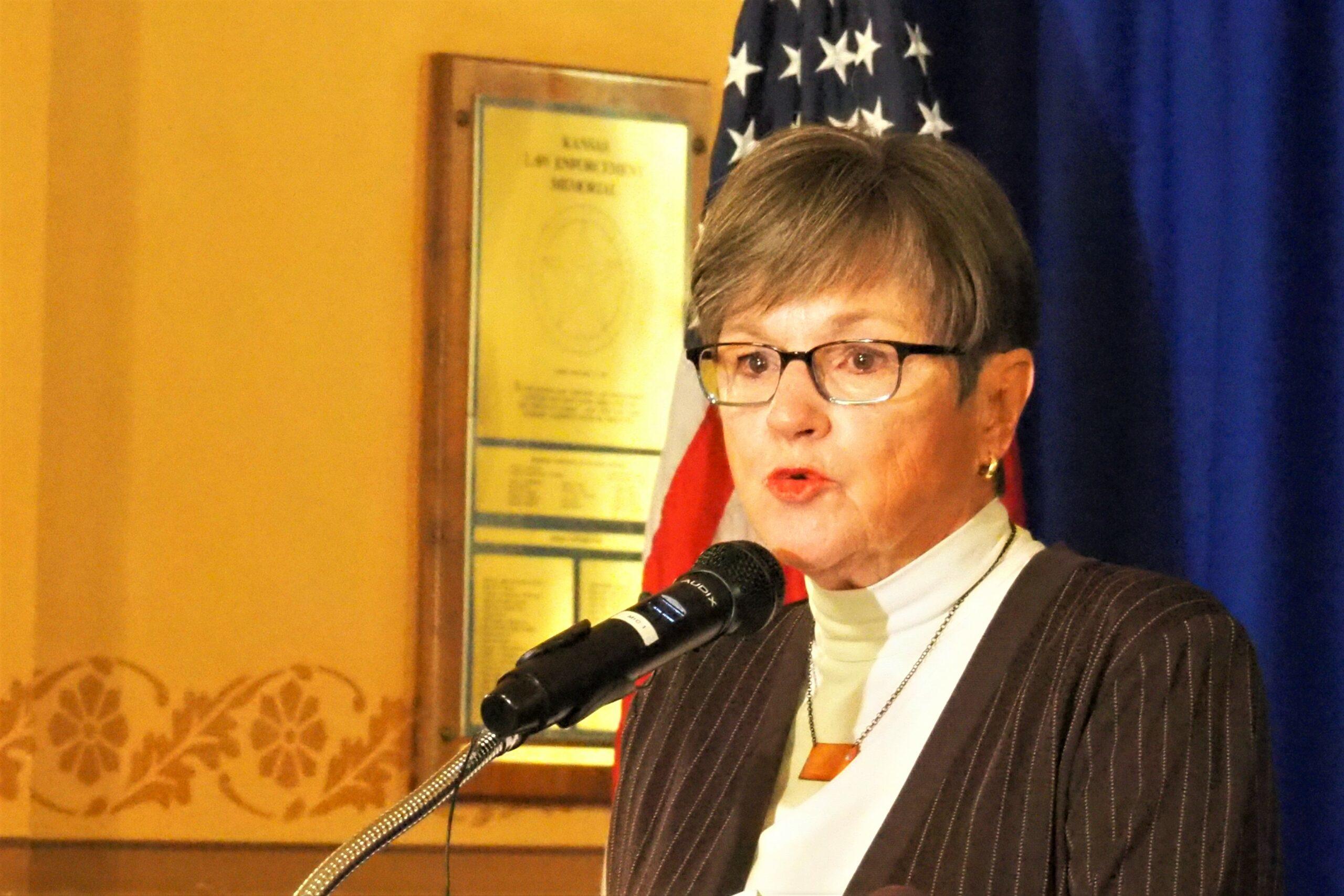 Kansas governor denounces effort to tie college athlete pay to transgender athlete ban