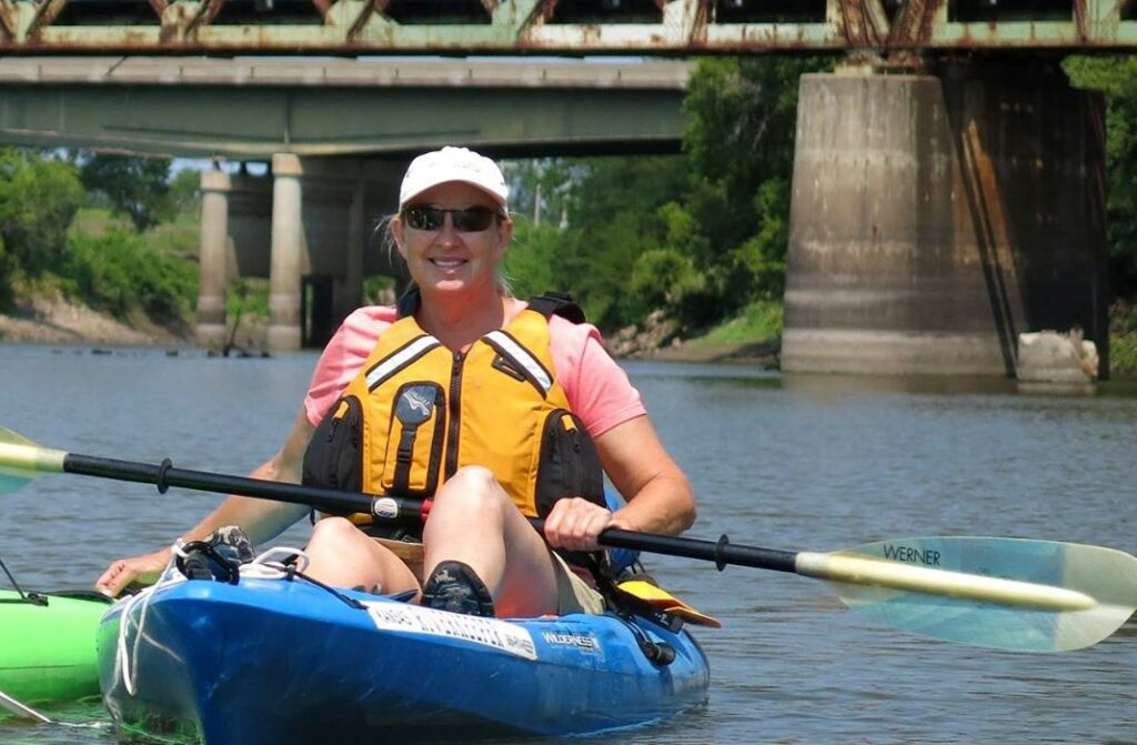 Dawn Buehler, executive director of Friends of the Kaw, strives to expand appreciation for the Kansas River's educational and recreational opportunities. Protecting water quality is a priority because the river is a source of drinking water for 800,000 people. (Photo by Greg Zolnerowich)
