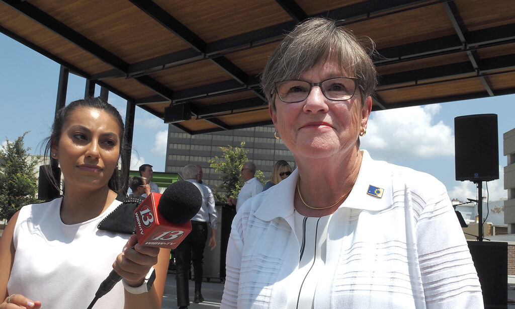 Gov. Laura Kelly said she hoped former Gov. Jeff Colyer had a swift recovery from a bout with cancer than prompted him to drop out of the 2022 governor's race. (Sherman Smith/Kansas Reflector)