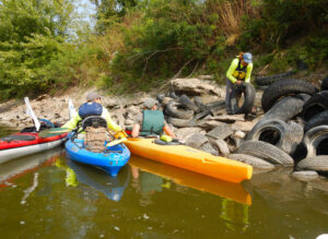 Friends of the Kaw has collaborated with city and state government officials as well as non-government organizations to pull unsightly piles of tires from the Kansas River. (Photo by Lisa Grossman)
