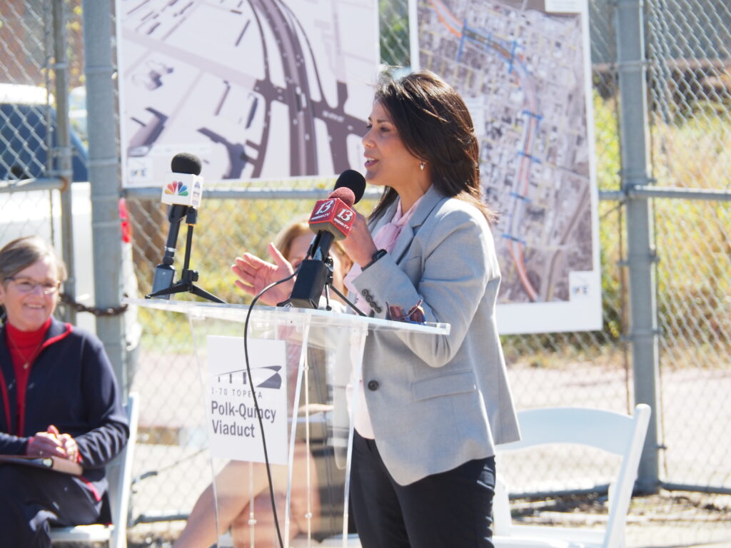 Topeka Mayor Michell De La Isla celebrated Wednesday the state and local partnership bringing to fruition a plea to spend more than $234 million to replace the Interstate 70 viaduct running through Topeka. (Tim Carpenter/Kansas Reflector)