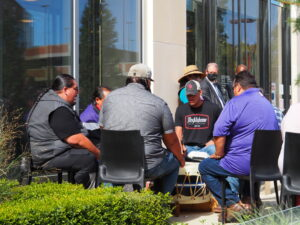 A drum circle was part of the ceremony marking reinstallation of artwork at Spencer Museum of Art by University of Kansas graduate Edgar Heap of Birds. His panels noting tribes that previously lived in what became Kansas were vandalized. (Tim Carpenter/Kansas Reflectdor)